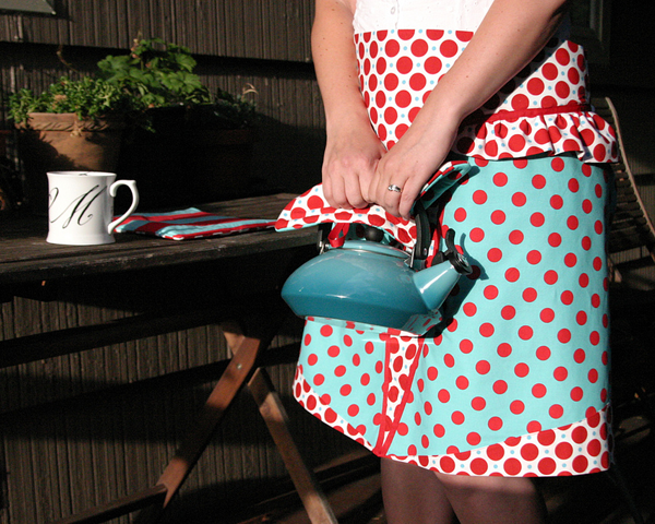 Bird and Bicycle apron on Le Crueset